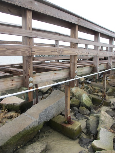 This portion of fishing pier built on concrete sleepers laid on the sand was destroyed in the hurricane. The deeper water area secured to pilings was not damaged. (Wave photo)