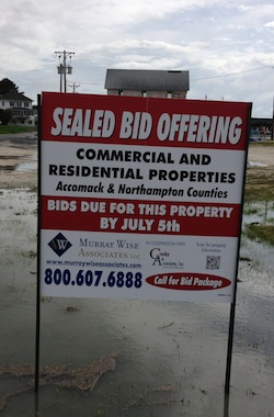 Brokerage sign for Madonia property for sale in Oyster. (Wave photo)