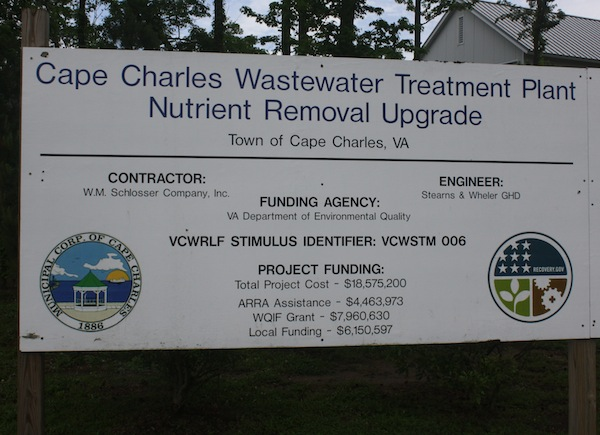 Signboard outside treatment plant shows a total cost of $18,575,200. Cost overruns and subsequent changes added another half million dollars which the Town must pay. (Wave photo)