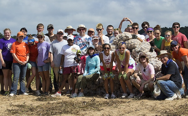 Volunteer gleaners: Like the hands in the background, hearts are at work. (Photo by Sher Horosko)
