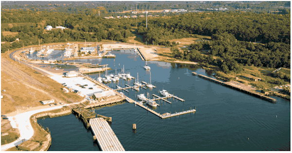 In this view of Cape Charles Town Harbor, the new Yacht Center will utilize the rectangular cutout at middle back of photo.