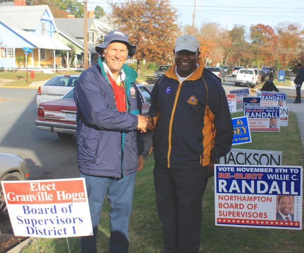 Candidates Hogg and Randall outside District 1 polling place Tuesday. The two are Butler's Bluff neighbors. (Wave photo)