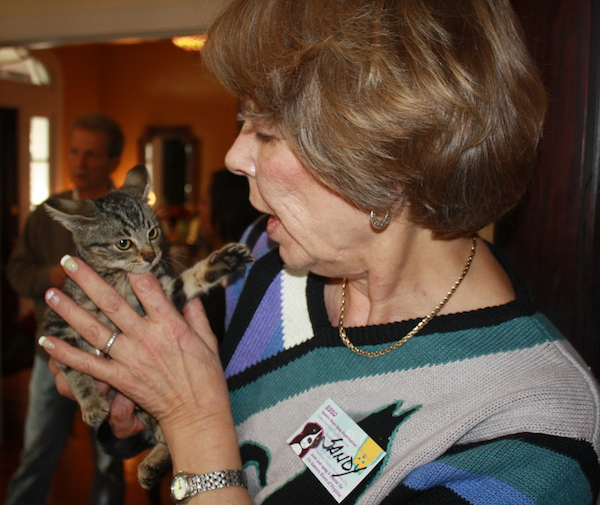 ESSO volunteer Sandy Mayer holds a trailer park kitten during last Sunday's fundraiser at Chesapeake Bay View B&B. (Wave photo)