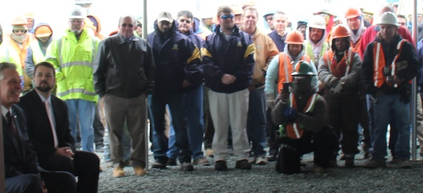 Bayshore Concrete employees applaud announcement of 135 new jobs.