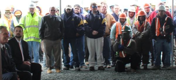 Bayshore Concrete employees applaud announcement of 135 new jobs.