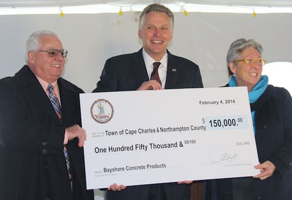 Gov. Terry McAuliffe presents check to Northampton County Board of Supervisors Chairman Larry LeMond and Cape Charles Mayor Dora Sullivan. The grant money goes to Bayshore Concrete Products in return for creating 135 jobs. (Wave photos)