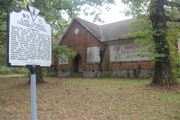 Historic marker reads: Cape Charles Colored School  Constructed in 1928, this school opened about 1930 for African American children in Cape Charles during legalized segregation. The building was constructed with contributions from the local African American community, the State Literary Fund, and the Julius Rosenwald Fund, established in 1917 to build schools for African American students in the rural South. Staffed by three teachers and a principal/teacher, the school housed grades one through seven, and was a center for educational, social, and cultural events for the African American community. Under Principal Jesse L. Hare, the school closed in 1966 when Northampton County Schools were consolidated four years before their integration.