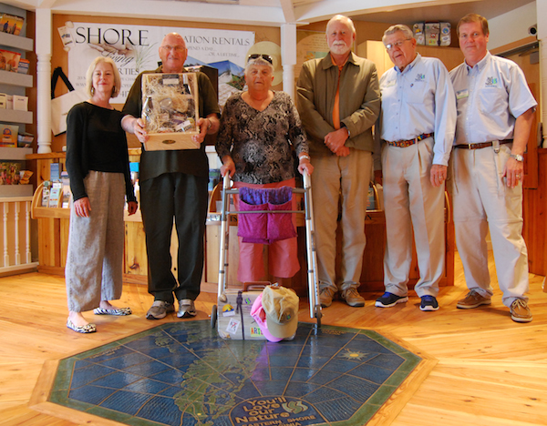 Kerry Allison, Executive Director of the ES Tourism Commission; Jacques and Shirley Dumoulin; Fred Stant, CBBT Commission Chairman; Allan Burns, ES Welcome Center Manager; and Bill Murphy, ES Welcome Center Volunteer.
