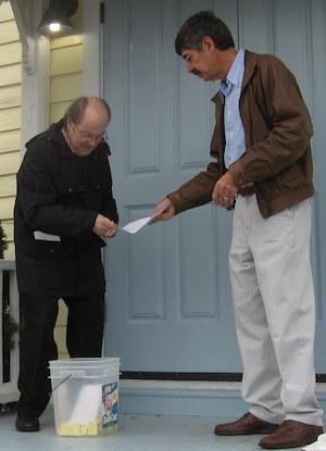 MAYER & MAYOR: Hank Mayer assists Mayer Proto in Thanksgiving Day golf cart raffle drawing.