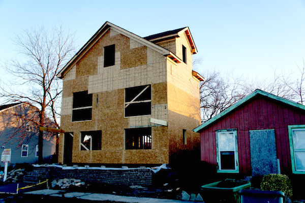House under construction at 404 Jefferson Avenue towers over its boarded-up neighbor. The Historic District Review Board vetoed sliding glass doors on the front of the house. (Wave photo)