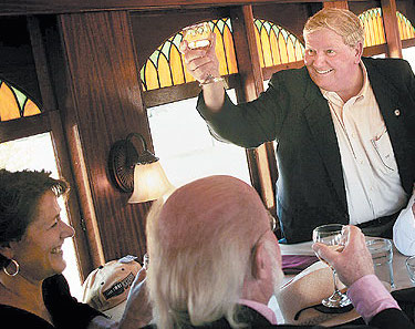 "Bay Creek developer Richard ""Dickie"" Foster toasts Oral and Mrs. Lamber during happier times in 2008. (Photo: Virginian-Pilot)"