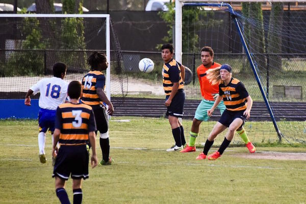 Number 18 Elian Morales fires a shot at the W&L goal. (Photo: Chris Glennon)